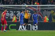 Ryan Bertrand of Chelsea receives a yellow card from referee Sergey Karasev as he gives a penalty during the UEFA Europa League Round of 16 match between FC Steaua Bucuresti and Chelsea at the National Arena on March 7, 2013 in Bucharest, Romania.