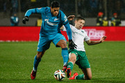 Hulk of FC Zenit St. Petersburg (L) and Daler Kuzyayev of FC Terek Grozny vie for the ball during the Russian Football League Championship match between FC Zenit St. Petersburg and FC Terek Grozny at the Petrovsky stadium on November 8, 2014 in St. Petersburg, Russia.