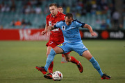 Luke Wilkshire of Sydney is challenged by Ryan Kitto of Adelaide during the FFA Cup Final match between Sydney FC and Adelaide United at Allianz Stadium on November 21, 2017 in Sydney, Australia.