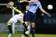 Scott SMITH of Charlestown (R) heads the ball against Alexander SCHIAVO of Heidelberg during the FFA Cup round of 32 match between Heidelberg United and Charlestown City Blues at Olympic Village on August 1, 2018 in Melbourne, Australia.
