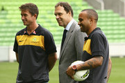 Harry Kewell, Holger Osieck Socceroos head coach and Archie Thompson pose for photos after speaking to the media during a Australian Socceroos FFA Press Conference at AAMI Park on November 22, 2011 in Melbourne, Australia.