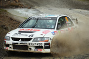 Tony Jardine and co-driver Amy Williams of Great Britain drive their Mitsubishi Lancer Evolution IX through a watersplash on the Sweet Lamb stage of the FIA World Rally Championship Great Britain on November 15, 2013 in Llanidloes, Wales.