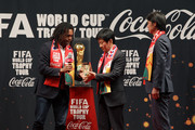 FIFA honorary ambassador Christian Karembeu (L) hands a replica World Cup Trophy to Chung Mong-Gyu (C), president of the Korea football association as stand South Korean national football team head coach Hong Myung-Bo (R) during the event of presentation as part of the FIFA World Cup Trophy that has now arrived to South Korea at Westin Chosun Hotel on April 4, 2014 in Seoul, South Korea.