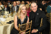 Actor Reese Witherspoon (L) and Jim Toth attend the 23rd Annual Critics' Choice Awards on January 11, 2018 in Santa Monica, California.