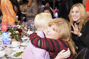 (L-R) Charlize Theron, Connie Britton and Mary McCormack attend FIJI Water at The Hollywood Reporter's 28th Annual Women in Entertainment Breakfast at Milk Studios on December 11, 2019 in Hollywood, California.