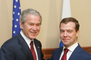 Russian President elect Dimitry Medvedev (R) shakes hands with US President George W. Bush during a bilateral meeting at the President's summer retreat Docharov Ruchei on April 06, 2008 in Sochi, Russia.  Bush's meeting with Russian President Vladimir Putin at Putin's vacation home comes on the heels of a NATO summit both leaders attended earlier in the week in Romania.