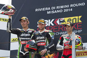 (L-R) Loris Baz of France and Kawasaki Racing Team, Tom Sykes of Great Britain and Kawasaki Racing Team, Marco Melandri of Italy and Aprilia Racing Team . celbrate on the podium at the end of the Superbike race 1 during the FIM Superbike World Championship - Race at Misano World Circuit on June 22, 2014 in Misano Adriatico, Italy.