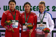 (L_R) Han Wang of China, Zi He of China and Tania Cagnotto of Italy pose on the podium afterthe Women's 3m Springboard finals during day two of the FINA/NVA Diving World Series 2014 at the Hamdan Sports Complex on March 21, 2014 in Dubai, United Arab Emirates.