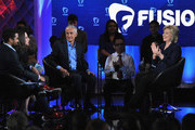 (L-R) Journalists Rembert Browne, Alicia Menendez and Jorge Ramos with democratic presidential candidate Hillary Rodham Clinton pictured onstage during the FUSION presents the Brown & Black Democratic Forum at Drake University on January 11, 2016 in Des Moines, Iowa.