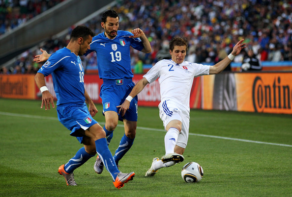Slovakia v Italy: Group F - 2010 FIFA World Cup [italy: group f - 2010 fifa world cup,player,sports,sport venue,soccer player,sports equipment,football player,soccer,team sport,ball game,football,fabio quagliarella,peter pekarik,gianluca zambrotta,challenge,slovakia,ellis park stadium,south africa,2010 fifa world cup south africa group f,match]