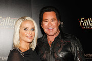 """Kathleen McCrone (L) and entertainer Wayne Newton arrive at the launch party for the video game """"Fallout: New Vegas"""" at the Rain Nightclub inside the Palms Casino Resort October 16, 2010 in Las Vegas, Nevada."""