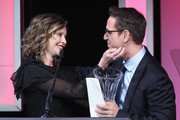 Honoree Greg Berlanti (R) accepts his award from actress Calista Flockhart onstage during the Family Equality Council Impact Awards on March 12, 2016 in Beverly Hills, California.