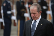 Former President George W. Bush watches as the casket of his father,  President George H.W. Bush, is carried from St. Martin's Episcopal Church following his funeral service December 6, 2018 in Houston, Texas. Bush, who died on November 30, will be buried on the campus of Texas A&M University behind his library center in College Station, Texas.