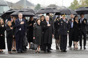 (AFP-OUT) George W. Bush, Laura Bush, and other family members arrive for a departure ceremony as the flag-draped casket of former President George H.W. Bush is carried by a joint services military honor guard on December 6, 2018 in Houston, Texas. President Bush will be buried at his final resting place at the George H.W. Bush Presidential Library at Texas A&M University in College Station, Texas. A WWII combat veteran, Bush served as a member of Congress from Texas, ambassador to the United Nations, director of the CIA, vice president and 41st president of the United States.