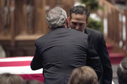 (AFP-OUT) George P. Bush embraces former President George W. Bush after giving a eulogy for former President George H.W. Bush during a funeral service at St. Martin's Episcopal Church, on December 6, 2018 in Houston, Texas. President Bush will be buried at his final resting place at the George H.W. Bush Presidential Library at Texas A&M University in College Station, Texas. A WWII combat veteran, Bush served as a member of Congress from Texas, ambassador to the United Nations, director of the CIA, vice president and 41st president of the United States.