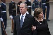 Former President George W. Bush and his wife Laura watch as the honor guard passes after loading the casket of President George H.W. Bush into a hearse outside St. Martin's Episcopal Church following his funeral service December 6, 2018 in Houston, Texas. Bush, who died on November 30, will be buried on the campus of Texas A&M University behind his library center in College Station, Texas.