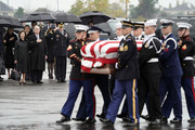 (AFP-OUT) Former President George W. Bush and Laura Bush watch as the flag-draped casket of former President George H.W. Bush is carried by a joint services military honor guard to a Union Pacific train on December 6, 2018 in Houston, Texas. President Bush will be buried at his final resting place at the George H.W. Bush Presidential Library at Texas A&M University in College Station, Texas. A WWII combat veteran, Bush served as a member of Congress from Texas, ambassador to the United Nations, director of the CIA, vice president and 41st president of the United States.