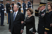 Former President George W. Bush and his wife Laura watch as the casket of President George H.W. Bush is carried from St. Martin's Episcopal Church following his funeral service December 6, 2018 in Houston, Texas. Bush, who died on November 30, will be buried on the campus of Texas A&M University behind his library center in College Station, Texas.