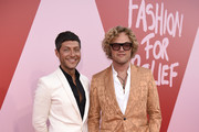 Peter Dundas (R) attends the Fashion for Relief event during the 70th annual Cannes Film Festival at Aeroport Cannes Mandelieu on May 21, 2017 in Cannes, France.