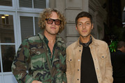 Peter Dundas and guest attend the Fashion Tech Lab Launch Event Hosted By Miroslova Duma And Stella McCartney as part of Paris Fashion Week Womenswear Spring / Summer 2018, on October 2, 2017 in Paris, France.