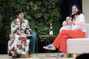 (R) Jared Leto in conversation with Fast Company Editor in Chief Stephanie Mehta (L) during Fast Company European Innovation Festival Powered By Gucci on July 10, 2019 in Milan, Italy.