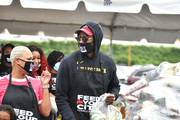 2 Chainz (R), his wife Kesha Ward Epps and son Halo Epps attend the Feed Your City Challenge on September 19, 2020 in Atlanta, Georgia. Feed Your City Challenge provided Atlanta's local community members with boxes of fresh groceries, PPE items, and voter registration stations.