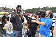 2 Chainz interviews with media during the Feed Your City Challenge on September 19, 2020 in Atlanta, Georgia. Feed Your City Challenge provided Atlanta's local community members with boxes of fresh groceries, PPE items, and voter registration stations.