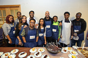 Tai Davis, Hannaha Hall, Barton Fitzpatrick, Common, Shamon Brown Jr., and Common Ground Foundation students volunteer at St Stephen AME Church in partnership with Feeding America, The Common Ground Foundation and Greater Chicago Food Depository on November 22, 2017 in Chicago, Illinois.