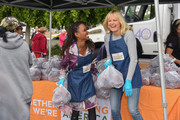 Shanola Hampton (L) and Malin Ã…kerman volunteer at the Feeding America and Los Angeles Regional Food Bank Team in a special volunteer event for Mother's Day on May 07, 2019 in Los Angeles, California.