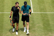 Bruno Soares of Brazil and Jamie Murray of Great Britain confer between points during their men's doubles match against Marcus Daniell of New Zealand and Wesley Koolhof of Netherlands during Day Four of the Fever-Tree Championships at Queens Club on June 21, 2018 in London, United Kingdom.