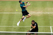 Jamie Murray of Great Britain returns a shot while playing with Bruno Soares of Brazil during their men's doubles match against Marcus Daniell of New Zealand and Wesley Koolhof of Netherlands during Day Four of the Fever-Tree Championships at Queens Club on June 21, 2018 in London, United Kingdom.