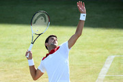 Novak Djokovic of Serbia serves during the match against Grigor Dimitrov of Bulgaria during Day four of the Fever-Tree Championships at Queens Club on June 21, 2018 in London, United Kingdom.