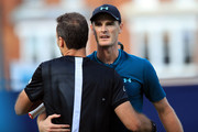 Jamie Murray of Great Britain celebrates with Bruno Soares of Brazil after their doubles victory over Adrian Mannarino and Fabrice Martin of France on Day 1 of the Fever-Tree Championships at Queens Club on June 18, 2018 in London, United Kingdom.