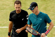 Bruno Soares of Brazil and Jamie Murray of Great Britain confer during their men's doubles semifinal match against Oliver Marach of Austria and Mate Pavic of Croatia on Day Six of the Fever-Tree Championships at Queens Club on June 23, 2018 in London, United Kingdom.