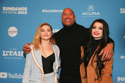 "Actress Florence Pugh, actor and producer Dwayne Johnson and Paige pose for a photo at a Sundance special screening of ""Fighting with My Family"" on January 28, 2019 in Park City, Utah."