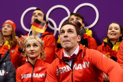 Aljona Savchenko and Bruno Massot of Germany await their scores with teammates after competing in the Figure Skating Team Event - Pair Skating Short Program during the PyeongChang 2018 Winter Olympic Games at Gangneung Ice Arena on February 9, 2018 in Gangneung, South Korea.