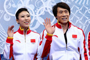 Qing Pang and Jian Tong of China wait for their score during the Figure Skating Pairs Short Program on day four of the Sochi 2014 Winter Olympics at Iceberg Skating Palace on February 11, 2014 in Sochi, Russia.