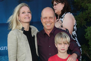 "Figure skater Scott Hamilton (C) poses with wife Tracie Robinson and son at Film Independent's 2012 Los Angeles Film Festival premiere of Disney Pixar's ""Brave"" at the Dolby Theatre on June 18, 2012 in Hollywood, California."