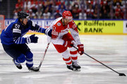 Kasperi Kapanen (L) of Finland and Frans Nielsen of Denmark battle for the puck during the 2018 IIHF Ice Hockey World Championship group stage game between Finland and Denmark at Jyske Bank Boxen on May 9, 2018 in Herning, Denmark.