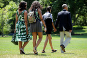 (L-R) U.S. first lady Michelle Obama, daughters Sasha Obama and Malia Obama, and President Barack Obama leave the White House before boarding Marine Oe on the South Lawn June 17, 2016 in Washington, DC. The first family is traveling to New Mexico and tour Carlsbad Caverns National Park to celebrate the 100th anniversary of the creation of America's national park system.