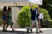 US President Barack Obama waves while walking with his daughter Malia (R), First Lady Michelle Obama (2nd L) and daughter Sasha (L) as they depart the White House in Washington, DC, June 17, 2016..The family is headed to New Mexico and California. / AFP / JIM WATSON