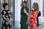 U.S. First Lady Melania Trump and Japan's first lady Akie Abe are given a tour of the Flagler museum by Erin Manning (R), executive director of the Museum, on April 18, 2018 in Palm Beach, Florida. The first ladies accompanied their husbands U.S. President Donald Trump and Japan's Prime Minister Shinzo Abe to Palm Beach.