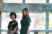 U.S. first lady Melania Trump and Japan's first lady Akie Abe stand together during a tour of the Flagler museum on April 18, 2018 in Palm Beach, Florida. The first ladies accompanied their husbands U.S. President Donald Trump and Japan's Prime Minister Shinzo Abe to Palm Beach.