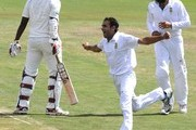 Imran Tahir  of South Africa celebrates the wicket of Thisara Perera of Sri Lanka during day 1 of the 1st Sunfoil Test match between South Africa and Sri Lanka at Supersport Park on December 15, 2011 in Pretoria, South Africa