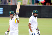 Imran Tahir looks on as Mark Boucher of South Africa celebrates his 50 during day three of the 1st Test match between South Africa and Sri Lanka at Supersport Park on December 17, 2011 in Pretoria, South Africa.