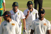 Mark Boucher and Imran Tahir of South Africa walk off the field during day two of the 1st Test match between South Africa and Sri Lanka at Supersport Park on December 16, 2011 in Pretoria, South Africa.