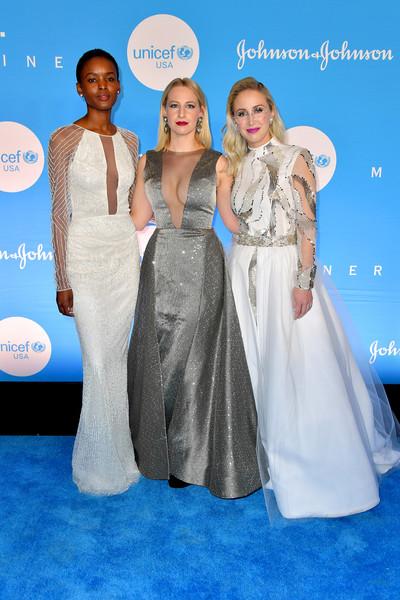 15th Annual UNICEF Snowflake Ball 2019 - Arrivals [clothing,dress,fashion,carpet,gown,shoulder,premiere,red carpet,event,bridal party dress,arrivals,sterling mcdavid,emily burnett,flaviana matata,l-r,new york city,wall street atrium,unicef,snowflake ball]