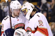 Mark Pysyk #13 of the Florida Panthers of the Florida Panthers celebrates with Roberto Luongo #1 after the Panthers defeat the Boston Bruins 4-2 at TD Garden on April 8, 2018 in Boston, Massachusetts.