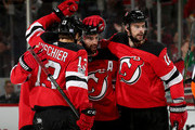 Kyle Palmieri #21 of the New Jersey Devils is congratulated by teammates Will Butcher #8,Nico Hischier #13 and Drew Stafford #18 after Palmieri scored a goal in the second period against the Florida Panthers on November 11, 2017 at Prudential Center in Newark, New Jersey.