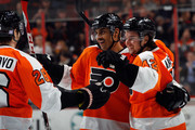 Pierre-Edouard Bellemare #78 of the Philadelphia Flyers (C) celebrates his second period goal against the Florida Panthers along with Carlo Colaiacovo #26 (L) and Jason Akeson #42 (R) at the Wells Fargo Center on November 6, 2014 in Philadelphia, Pennsylvania.